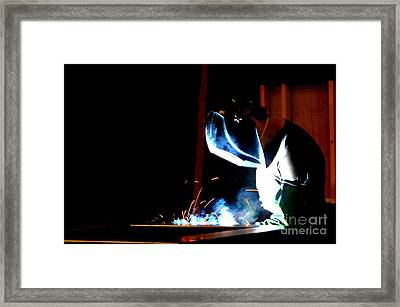 The Welder Framed Print