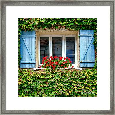 The Window With The Geraniums And The Blue Shutters Framed Print by Olivier Le Queinec