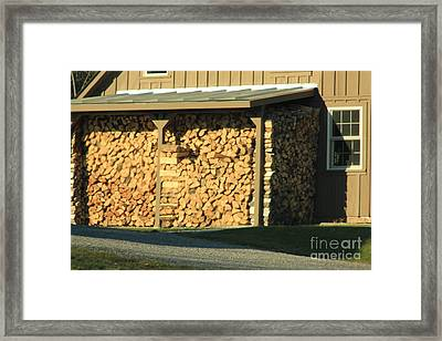 The Wood Pile Framed Print