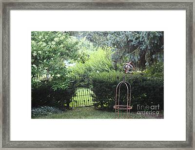 The Wrought Iron Gate Framed Print by Yvonne Wright