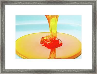 Thick Golden Liquid Being Poured Framed Print