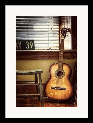 Toy Guitar Framed Prints