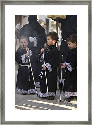 Three Boys At The Procession Framed Print by Perry Van Munster