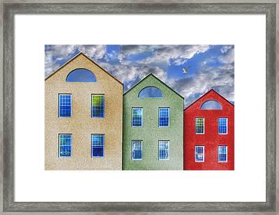 Three Buildings And A Bird Framed Print by Paul Wear
