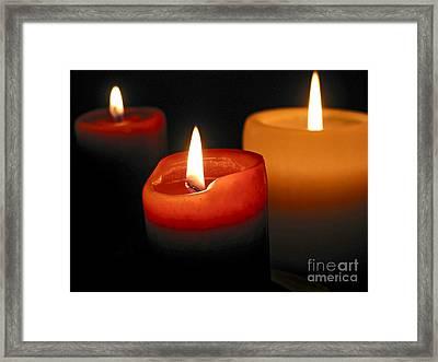 Three Burning Candles Framed Print