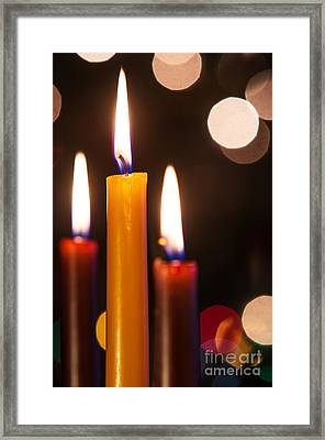 Three Candles Framed Print