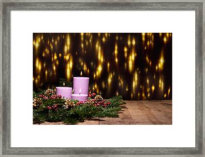 Three Candles In An Advent Flower Arrangement Framed Print