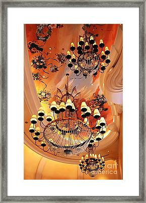 Three Chandeliers Framed Print by John Rizzuto