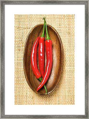 Three Chili Peppers In Wooden Bowl Framed Print