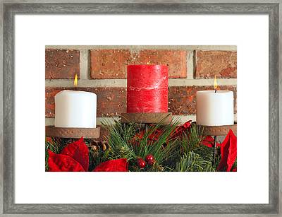 Three Christmas Candles Framed Print