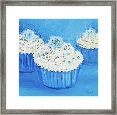 Three Delicious Cupcakes In A Blue Kitchen Framed Print