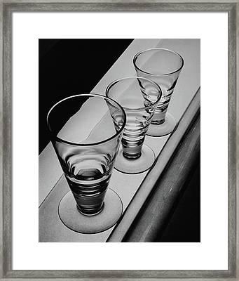 Three Glasses On A Shelf Framed Print