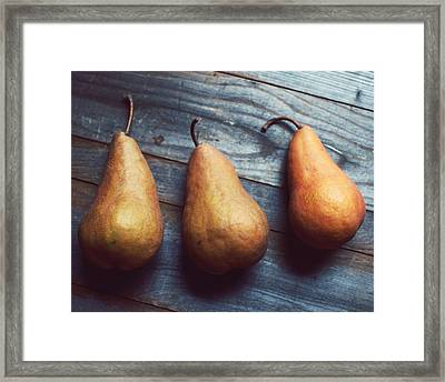Three Gold Pears Framed Print by Lupen  Grainne