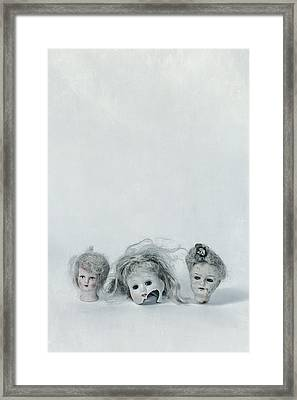 Three Heads Framed Print