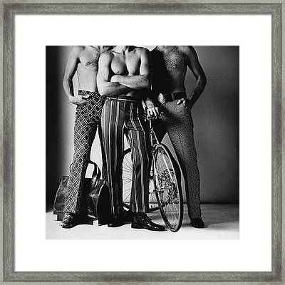 Three Male Models Wearing Patterned Trousers Framed Print