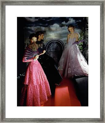 Three Models Wearing Ball Gowns Framed Print