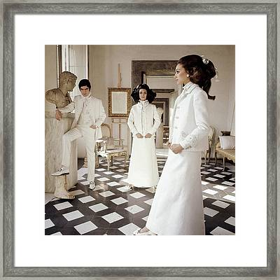 Three Models Wearing Clothing By Valentino Framed Print