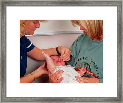 Three-month-old Boy Receiving Polio Vaccination Framed Print by Simon Fraser/science Photo Library