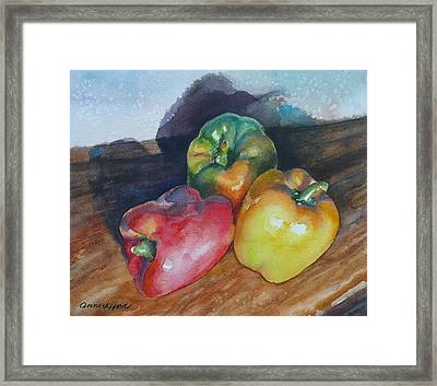 Three Peppers Framed Print by Anne Gifford