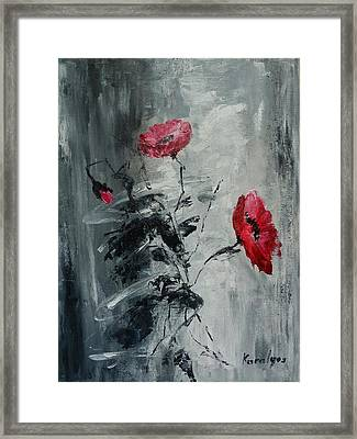Three Poppies Framed Print by Maria Karalyos