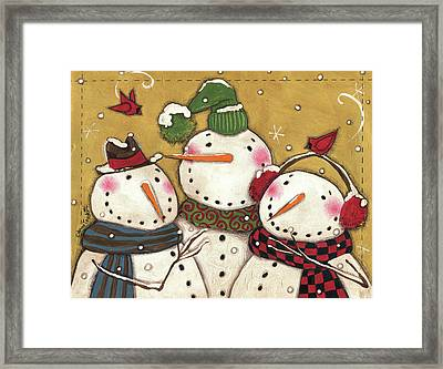 Three Snowmen Framed Print by Anne Tavoletti
