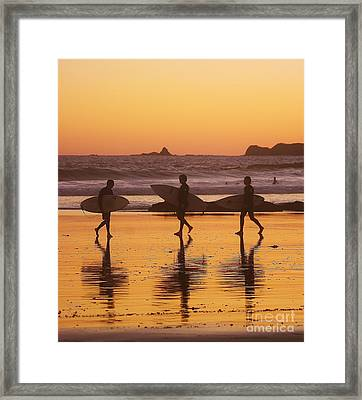 Three Surfers At Sunset Framed Print