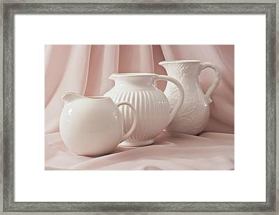 Three White Pitchers Framed Print by Sandra Foster