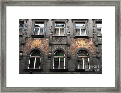 Three Windows In Prague Framed Print by John Rizzuto