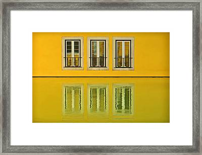 Three Windows Reflecting In The Water Framed Print