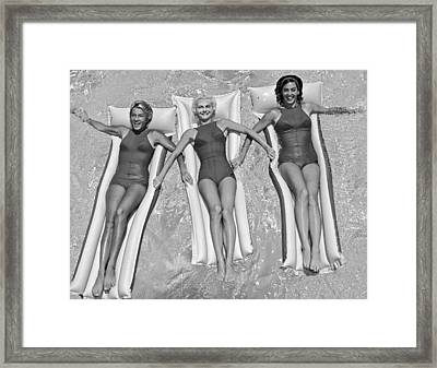 Three Women Floating In A Pool Framed Print by Underwood Archives