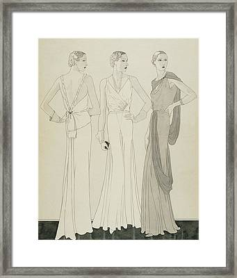 Three Women Wearing Evening Dresses By Maggy Framed Print by Douglas Pollard