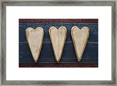 Three Wooden Hearts Framed Print by Carol Leigh