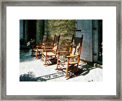 Three Wooden Rocking Chairs On Sunny Porch Framed Print by Susan Savad