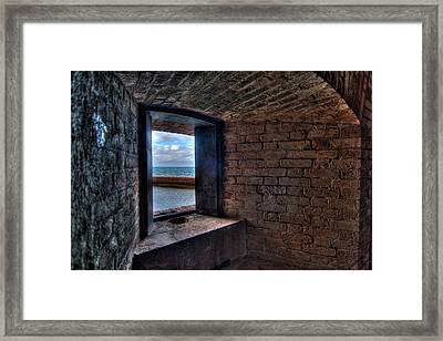 Through The Fort Window Framed Print by Andres Leon