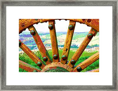 Framed Print featuring the photograph Through The Old Wheel by Marwan Khoury
