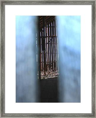 Through The Slats Framed Print
