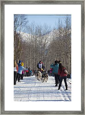 Through Trees And People Framed Print