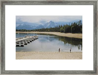 Throwing Rocks Framed Print