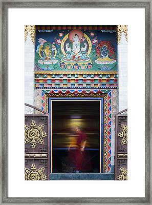 Tibetan Monk And The Prayer Wheel Framed Print by Tim Gainey