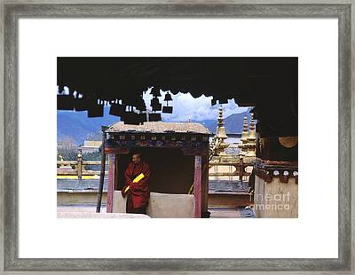 Tibetan Monk With Scroll On Jokhang Roof Framed Print by Anna Lisa Yoder