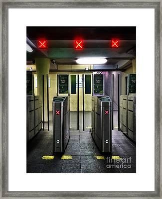 Ticket Gates Framed Print by Carlos Caetano