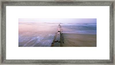 Tide Break On The Beach At Sunrise Framed Print by Panoramic Images
