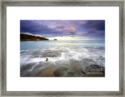 Tide Covered Pavement Framed Print by Mike  Dawson