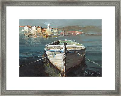Tied Boat By The City Framed Print by Branko Dimitrijevic