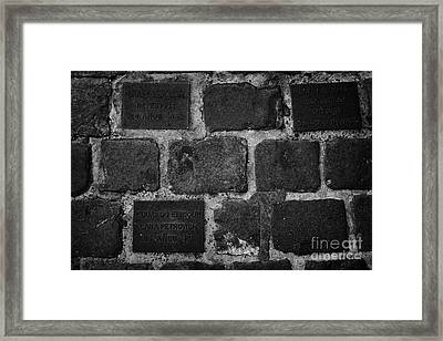 tiles in the footpath to those killed or disappeared outside former prison and torture house in calle londres barrio paris londres Santiago Chile Framed Print