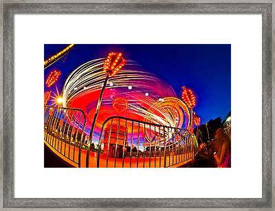 Time Exposure Of A Carnival Ride Framed Print by Panoramic Images