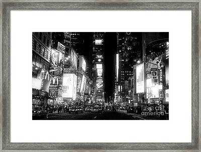 Times Square At Night Framed Print by John Rizzuto