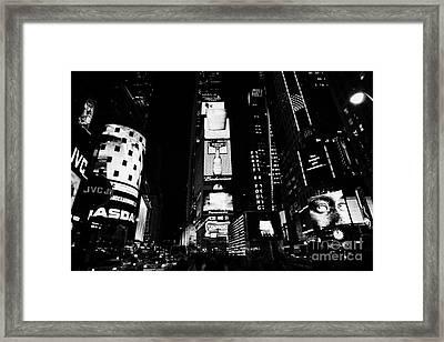 Times Square In Nighttime Manhattan New York City Framed Print by Joe Fox