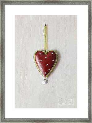 Framed Print featuring the photograph Tin Heart Hanging On Wood by Sandra Cunningham