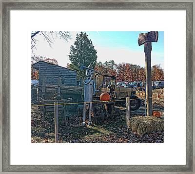 Tin Man At Work Framed Print